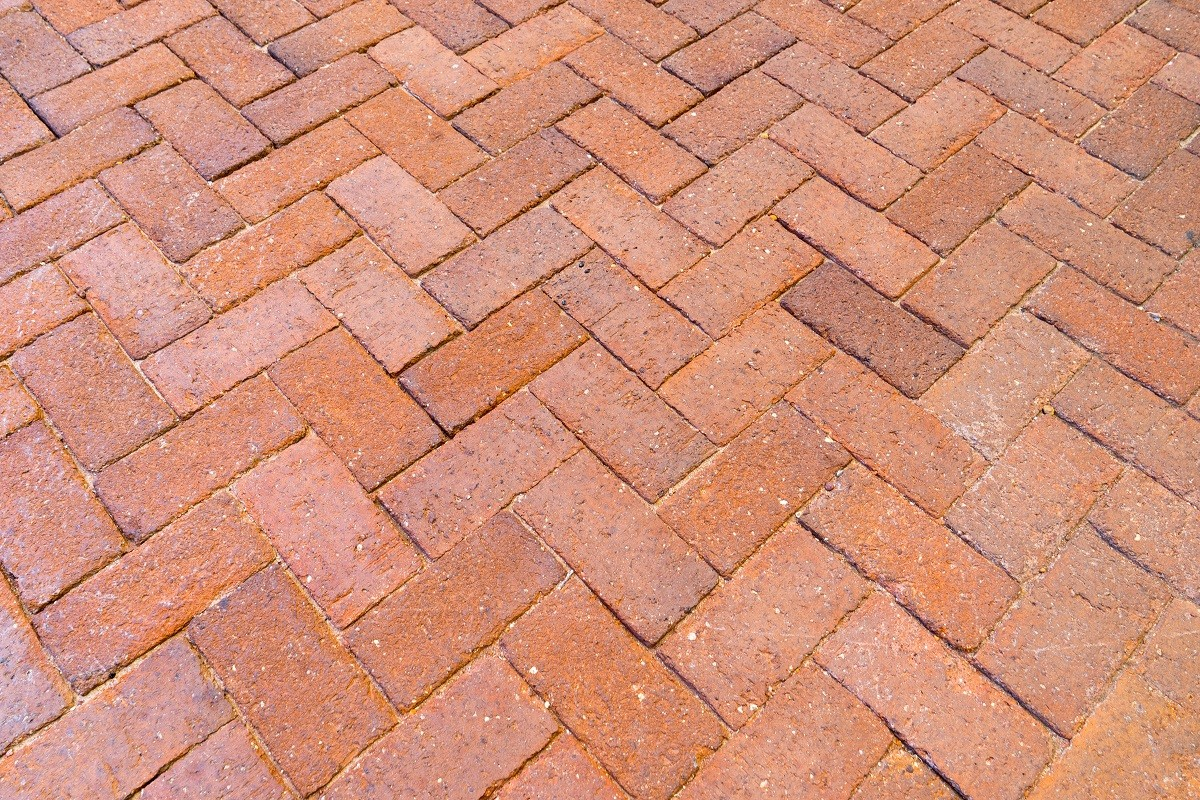 Red Paving Stones : Red brick paving stones on a sidewalk the grout specialist