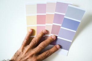 grout installation image of colorful paper strips